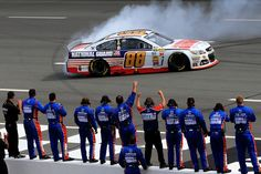 Dale Earnhardt Jr., driver of the #88 National Guard Chevrolet, celebrates with a burnout in front of his team after winning the NASCAR Sprint Cup Series Pocono 400 at Pocono Raceway on June 8, 2014 in Long Pond, Pennsylvania.  http://www.pinterest.com/jr88rules/nascar-2014/ #NASCAR2014