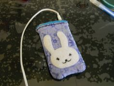 An iPod sleeve I made for my iPod. It came out a little small but it works. Yes, it was Bleach inspired. Side 1