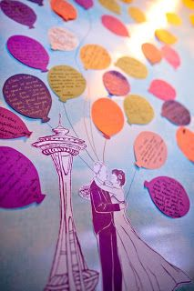 A unique guest book idea... guests wrote messages on the balloons to the couple and attached them to the canvas featuring the Seattle Space Needle and embracing bride & groom. From A Heavenly Ceremony blog, photo by Mike Kane.