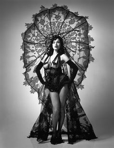 """Dita Von Teese in Jean Paul Gaultier """"Circé"""" ensemble - Haute Couture Summer 2003 (Black hat-gown of lace appliqué on fine straw and black horsehair, jet pin; black lace bloomers; black fishnet tights)"""