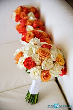 Orange and white brides and bridesmaids bouquet with roses and calla lilies by Helen G Events and Helen G Decor for wedding in Montego Bay Jamaica