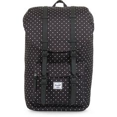 """The Herschel Supply Little America mid-volume backpack has all over white polka dots on a black body. This rucksack style pack has a 13"""" padded laptop sleeve, drawcord closure, and a top flap with magnetic snaps and rubber strap details for better wear in Okay I fell in love with this backpack but not with the price,,"""