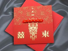 "Double happiness with dragon and phoenix pattern Chinese Wedding Invitation, the red and gold cord tied onto the card that represented the meaning of  ""Faraway destinies united by a string"", also wrote on the card."