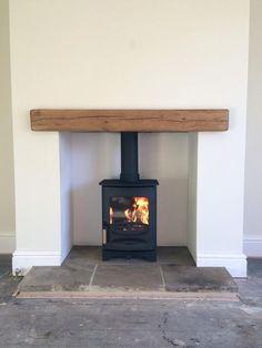 @Fahrenheit Stoves Ltd: @Charnwood C-Four, reclaimed Yorkshire stone hearth, oak fireplace beam