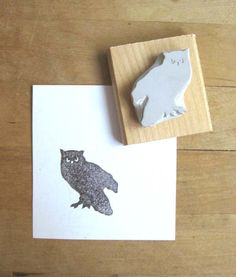 A lovely little owl silhouette stamp hand-carved out of rubber. The stamp is mounted on a piece of sanded salvaged wood. It comes in a recycled plastic and cardboard package. Use it to decorate your own cards, decorative/wrapping papers, stationary, packaging, etc.! The possibilities are
