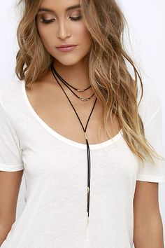 """You're obviously star material with an accessory like the Stelliferous Gold and Black Choker Necklace around your neck! Black vegan leather choker strands with gold beads lay above a bolo-style necklace with pendant ends. Shortest strand measures 14"""" around with a 3"""" extender chain."""