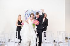 Mikkel Paige Photography photo of Dobbin St Brooklyn wedding. Planning and coordination by Color Pop Events. Ceremony confetti toss with clear chiavari chairs and custom art splatter paint backdrop for the bride and groom's first kiss.