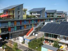 Designed by Rolf Disch, the Sonnenschiff (Solar Ship) and Solarsiedlung (Solar Village) emphasize power production from the start by smartly incorporating a series of large rooftop solar arrays that double as sun shades. The buildings are also built to Passivhaus standards, which allows the project to produce four times the amount of energy it consumes!