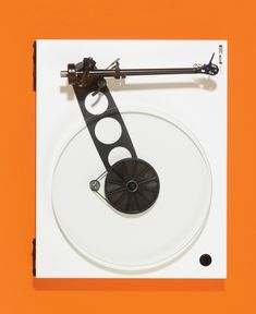 Rega RP3 - I don't listen to vinyl but I would have this just because of how it looks against orange