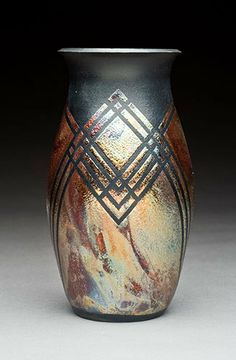 Raku Vase with square pattern. I like the contrast of the metal look and the black of the vase.