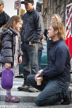 World War Z hits Blu-ray and DVD today, and we're sharing a newly released, exclusive picture of Brad Pitt in a candid moment on the set of the film. Brad is Brad Pitt Hair, Brad Pitt And Angelina Jolie, Jolie Pitt, Sterling Jerins, Brad Pitt Pictures, Tyler Durden, Kris Kristofferson, Leonardo Dicaprio, In Hollywood