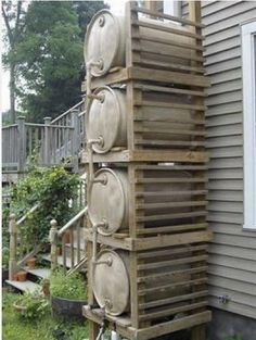 "Rain barrel ""tower"" for added capacity and pressure. I need to figure out some rain barrel system to store water for the horses so I don't have to lug so much. I've got three nice steel barrels, just need to figure out how to hook them up. Outdoor Projects, Garden Projects, Rainwater Harvesting, Water Storage, Dream Garden, Garden Landscaping, Homesteading, Outdoor Gardens, Pergola"