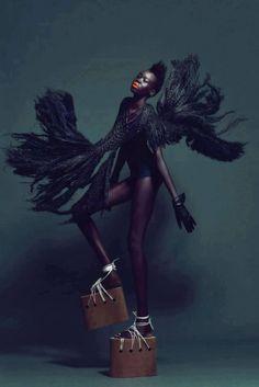 Alek Wek. Black Swan Le Frou Frou feathers & killa platforms #fashion #editorial #movement