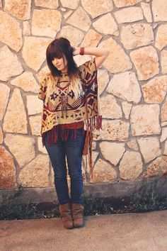 What a cute boho outfit for fall. Love the fringed Flying Tomato poncho. Roots and Feathers.
