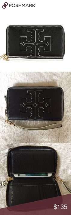 Brand New Tory Burch Smartphone Wristlet Black leather with white trim. Tory burch contrast logo smartphone wristlet. Fits both iPhone 6 and 7 very comfortably. Brand new. Retail price is 175 Tory Burch Bags Clutches & Wristlets