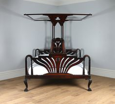 Here is an unusual and quirky antique super king Art Deco colonial Raj four-poster bed, circa 1920, in excellent original condition.  Summary: •