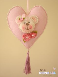 Felt heart with teddy bear face and flowers