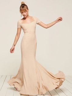 Remember: friends don't make friends wear ugly dresses. This is a floor length gown with a sweetheart neckline, short sleeves and a center back zipper.