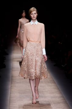 Valentino Spring 2013  As much lace as there was, monotone pairings—from blouse, to skirt, to bag to shoe—would keep even a minimalist happy. The accessories were of special note: little clutches in different colors and materials. One marble-like pink, another red python, or a silver detailed butterfly minaudière.