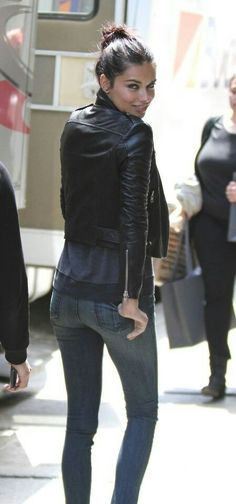 Adriana Lima looking perfect. That's how you wear a leather jacket and skinnies!
