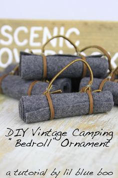 DIY Ornament: Vintage Camping Bedroll, DIY and Crafts, How to make DIY Ornaments - Camping and Hiking Themed for this year. Make this easy vintage bedroll ornament using felt, wire and leather lace. Diy Christmas Ornaments, Felt Ornaments, Holiday Crafts, Christmas Decorations, Christmas Ideas, Beaded Ornaments, Felt Christmas, Camping Decorations, Fabric Ornaments