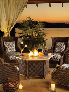Tommy Bahama - Island Estate Lanai collection. Outdoor wicker wing chairs and gas fire pit.