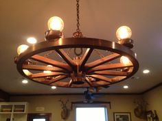 Learn To Decorate In A Creative Rustic Lighting Ideas It can be a complicated process for some people to tackle a project of home interior design. Antique Light Bulbs, Rustic Light Fixtures, Kitchen Lighting Fixtures, Farmhouse Lighting, Rustic Lighting, Farmhouse Kitchen Decor, Large Rustic Chandeliers, Iron Chandeliers, Wagon Wheel Light