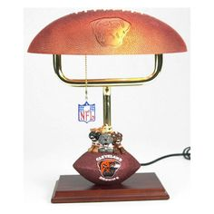 NFL - Cleveland Browns Desk Lamp. *NFL Team Mascot Football Lamps are made of resin*Each lamp has the team mascot perched on top of a football displaying the official team logo on the front with NFL and Wilson logos on the back*Lamp is approximately 14 inches tall*Offically licensed by NFL.. Price: $99.99