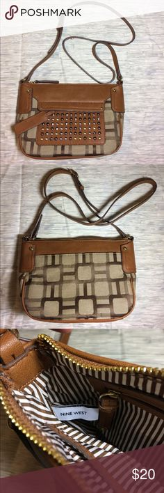 Nine West Purse This is a NWOT Nine West pure. The inside is clean and there is no wear on the bag as it was never used. It has adorable studding on the front. Has a buckle/belt adjustable strap. Nine West Bags Crossbody Bags