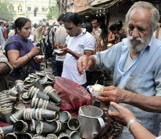 India - People having Kulfi on street