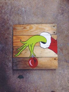 The Grinch on pallet wood! Perfect for fun Christmas decor. #christmasdecor…