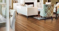 Complete with a warm classic hue, Pergo's Butterscotch Oak 2.25 in. laminate floor adds a traditional yet timeless feel to living rooms.