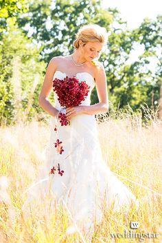 A beautiful bridal portrait from our styled wedding shoot - Wanderlust! http://www.weddingstar.com/product/2014-weddingstar-magazine {bride, bouquet, red, summer wedding, outdoor wedding, theme wedding, wedding dress}