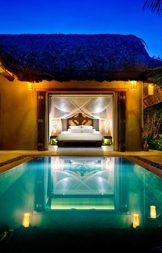 This would me so romantic. A secluded home on the ocean. Where the master bedroom opens up to a pool.