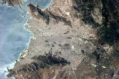 Chris Hadfield ‏@Cmdr_Hadfield 10 May 2013  Athens, Greece, with the reflecting sun showing the wind on the water.   | Twitter