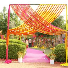 wedding entrance 25 Fun & Fab Mehendi Decor Ideas From Real Indian Couples' Celebrations Indian Wedding Theme, Desi Wedding Decor, Wedding Hall Decorations, Flower Decorations, Indian Weddings, Wedding Themes, Wedding Dresses, Wedding Gate, Wedding Entrance