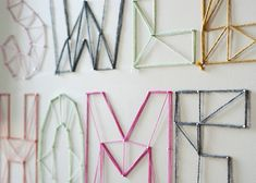 DIY: nail and yarn text wall art