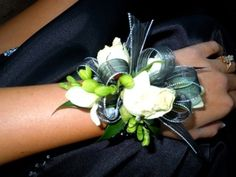 Prom Flowers - Wrist corsage for Prom.Assorted white flowers with metalic blue ribbon