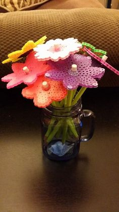 Perler bead flowers with pencil stems in a mason jar. I made this for Jacob's teacher gift!