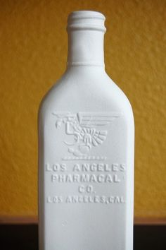 A vintage (1956) pharmacy bottle cast in translucent porcelain. (I have a thing for old bottles,don't ask why)!