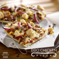 Fire up the grill for this fresh and fabulous BBQ chicken pizza.  A crunchy baguette makes for a perfect crust. Layer it up with chicken, red onion, barbecue sauce, bacon pieces and cheese.