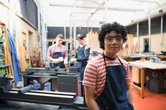 Portrait confident high school student in workshop