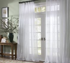 Curtains with French Doors- this is what I want for the sliding doors instead of the awful vertical blinds
