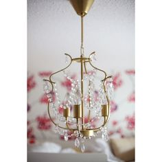 i've been waiting all winter for mild enough temps to finally spray paint lila's old chandelier. this past weekend i did just that, and i'm so happy to have c