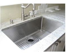 """Krauss 32"""" single bowl sink.  Like it rounded, rather than squared edges. Love the rack that comes with it."""