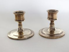 Pair of small brass candle holders. Dating to circa mid / late century. Standing approx from base to rim. Base diameter approx Pre-owned and used. Candelabra, Candlesticks, Brass Candle Holders, Late 20th Century, Home Decor Accessories, Retro Vintage, Dating, Base, Antiques