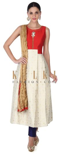 Buy this Featuring cream brocade suit with fancy tassel only on Kalki