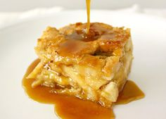 APPLE RUM BREAD PUDDING  WITH BUTTERSCOTCH RUM SAUCE 1 loaf french bread, cut into 1 inch cubes, about 5 1/3 cups  1 cup whole milk 1/3 cup brown sugar 1/3 cup granulated sugar 1 cup heavy cream 2 eggs 2 egg yolks  1 tsp vanilla extract 1 tsp + 1/2 tsp cinnamon  2 tbsp rum   2 large apples, peeled and cored, cut into thin slices or cubes (whichever you prefer)