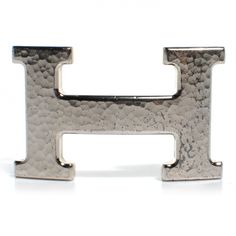This is an authentic HERMES 32mm Palladium H Belt Buckle in Hammered Silver.  This is a stylish accessory that can add a touch of Hermes sophistication to your outfit.  Wear this palladium silver buckle with a hammered effect with an Hermes belt strap of any color for a distinctive look, from Hermes!