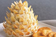 This Pinecone Cheese Spread is such a cute centerpiece for your holiday party! A creamy mix of five cheeses plus Dijon mustard and almond slices will have guests pining for more.
